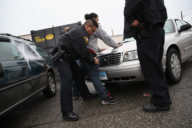 New London police officers search a suspect
