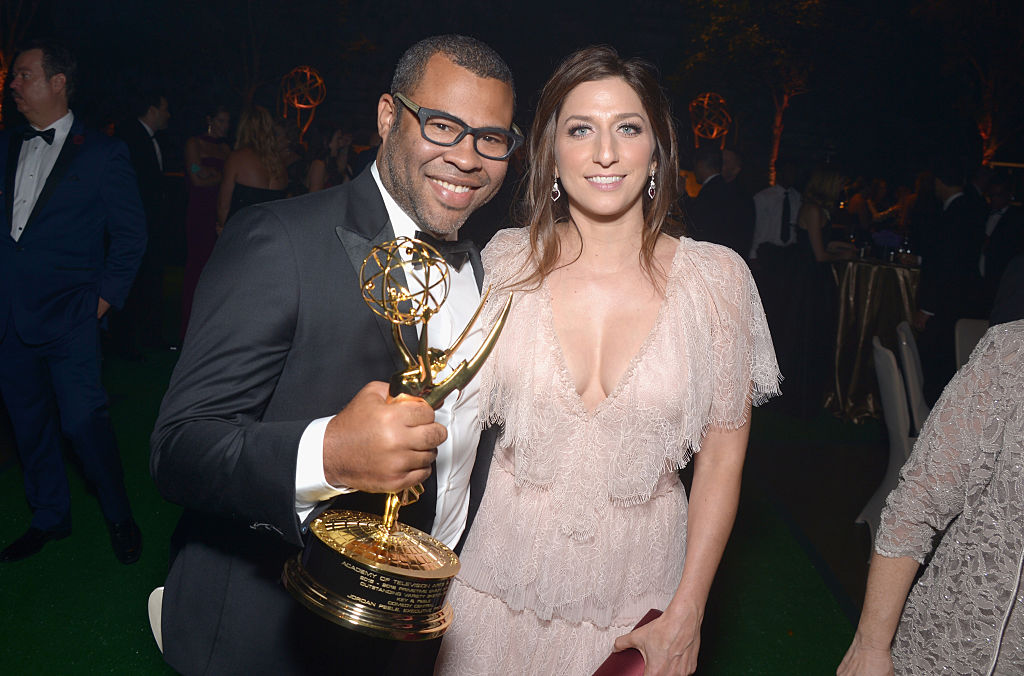 Jordan Peele with an Emmy in hand, standing next to Chelsea Peretti