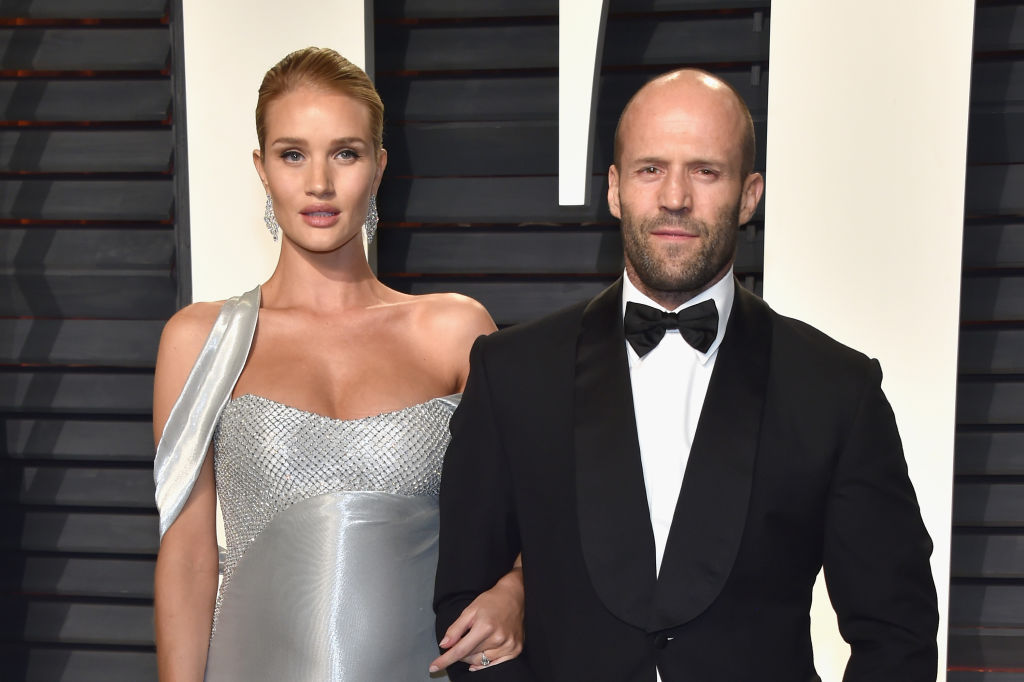 Rosie Huntington-Whiteley and Jason Statham smiling together on the red carpet