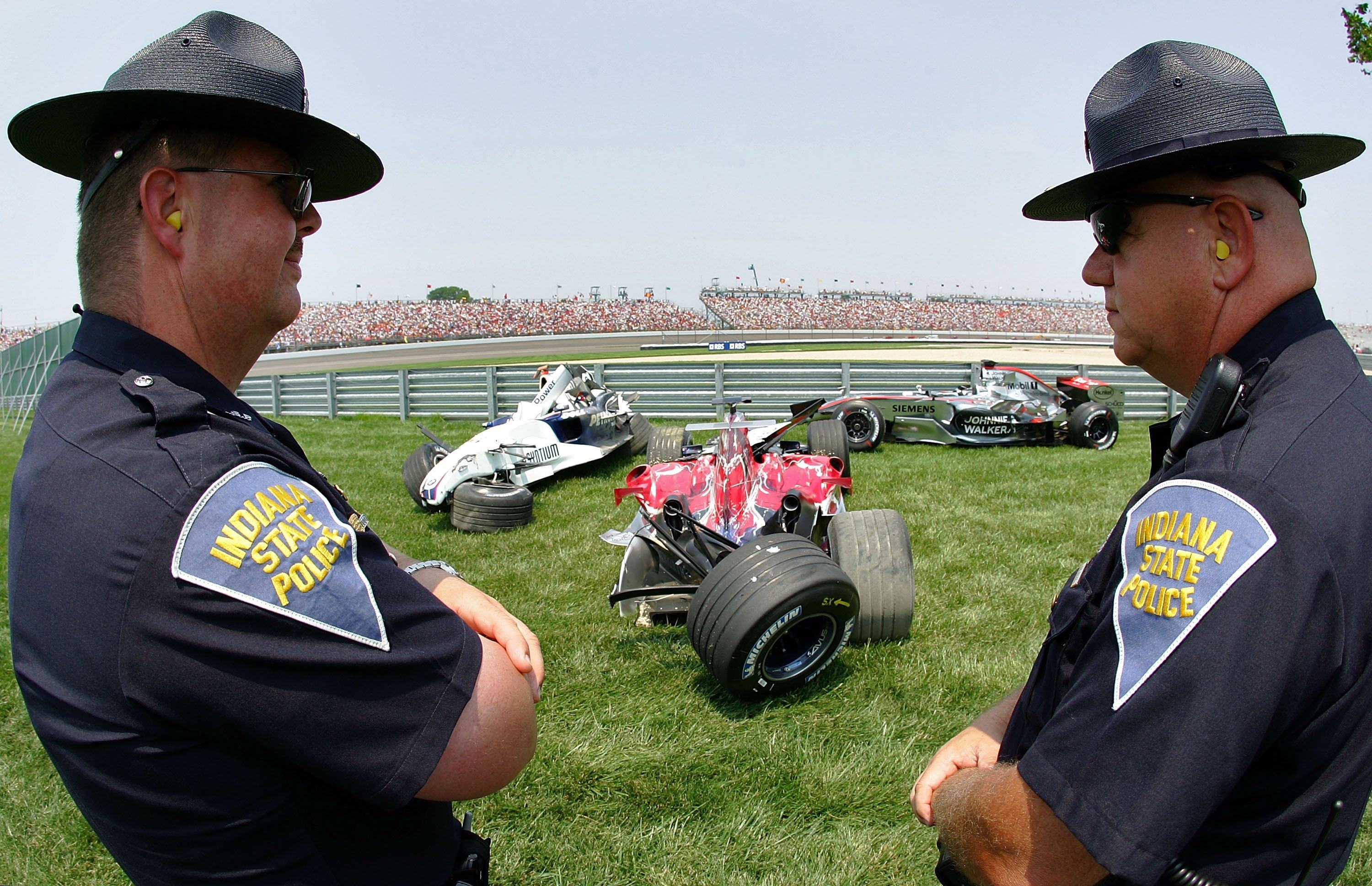 Indiana State Police look at wreckage after a crash