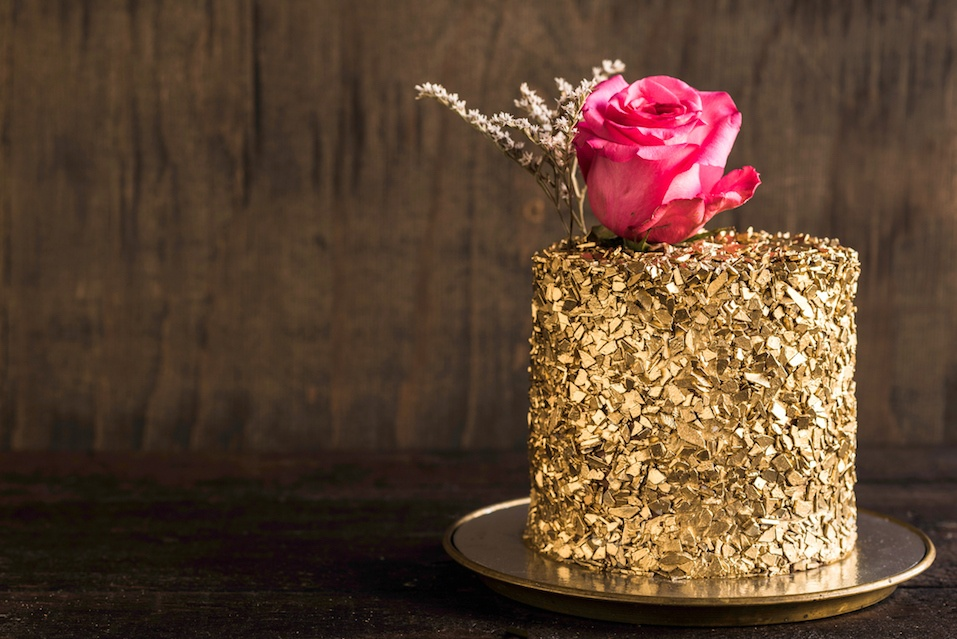 Golden chocolate cake on wooden background