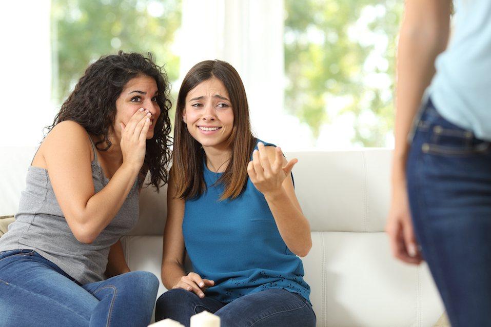 Gossip girls criticizing another woman