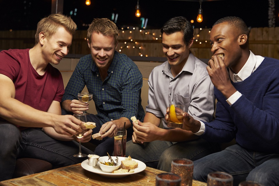 group of men enjoying dinner