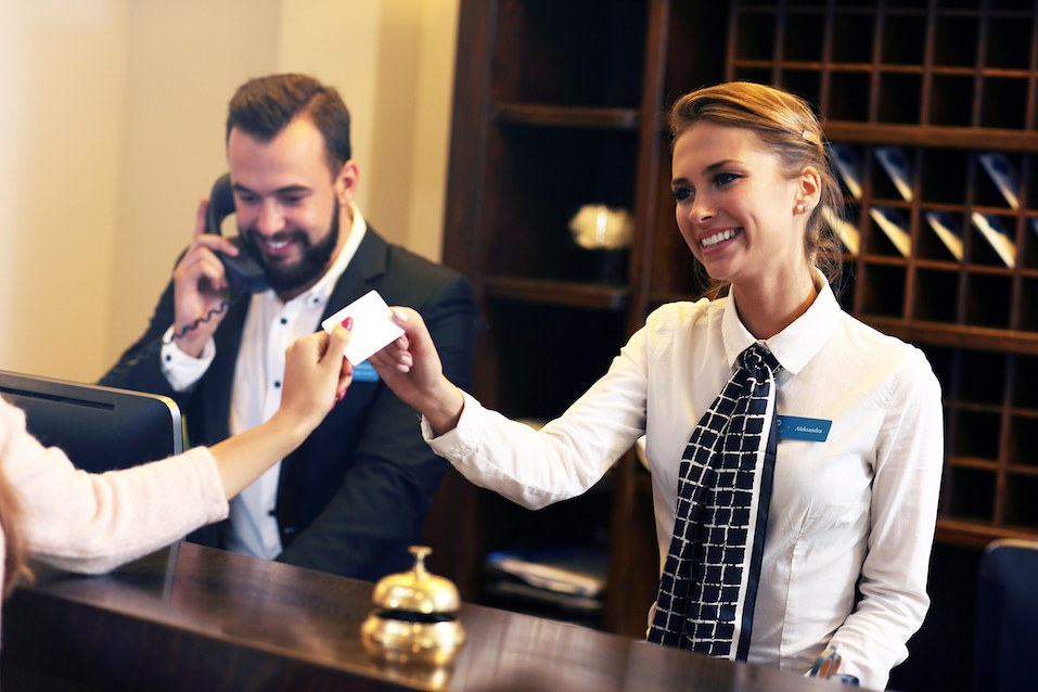 Picture of guests getting key card in hotel