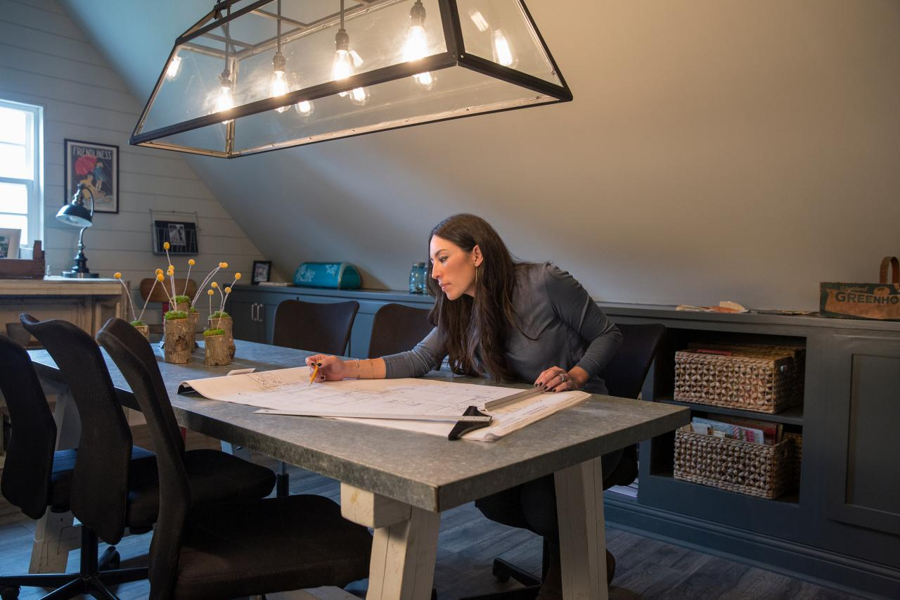 Joanna Gaines drafts designs at a sketch table for HGTV's Fixer Upper