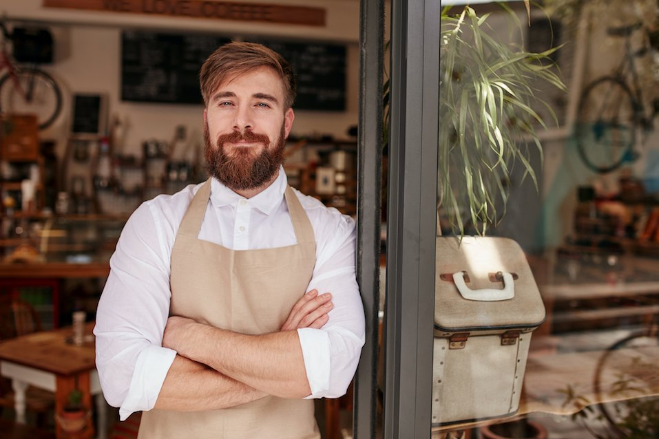 man in apron smiles