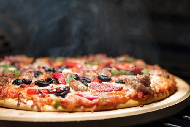 Pizza could be the reason your stomach hurts.