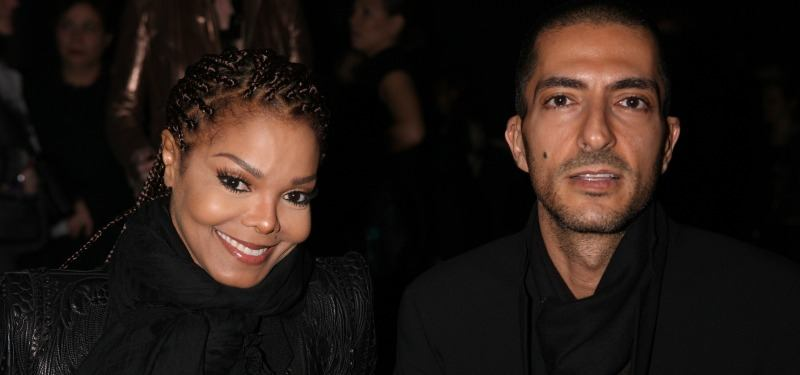 Janet Jackson and Wissam Al Mana wearing black smile at the camera
