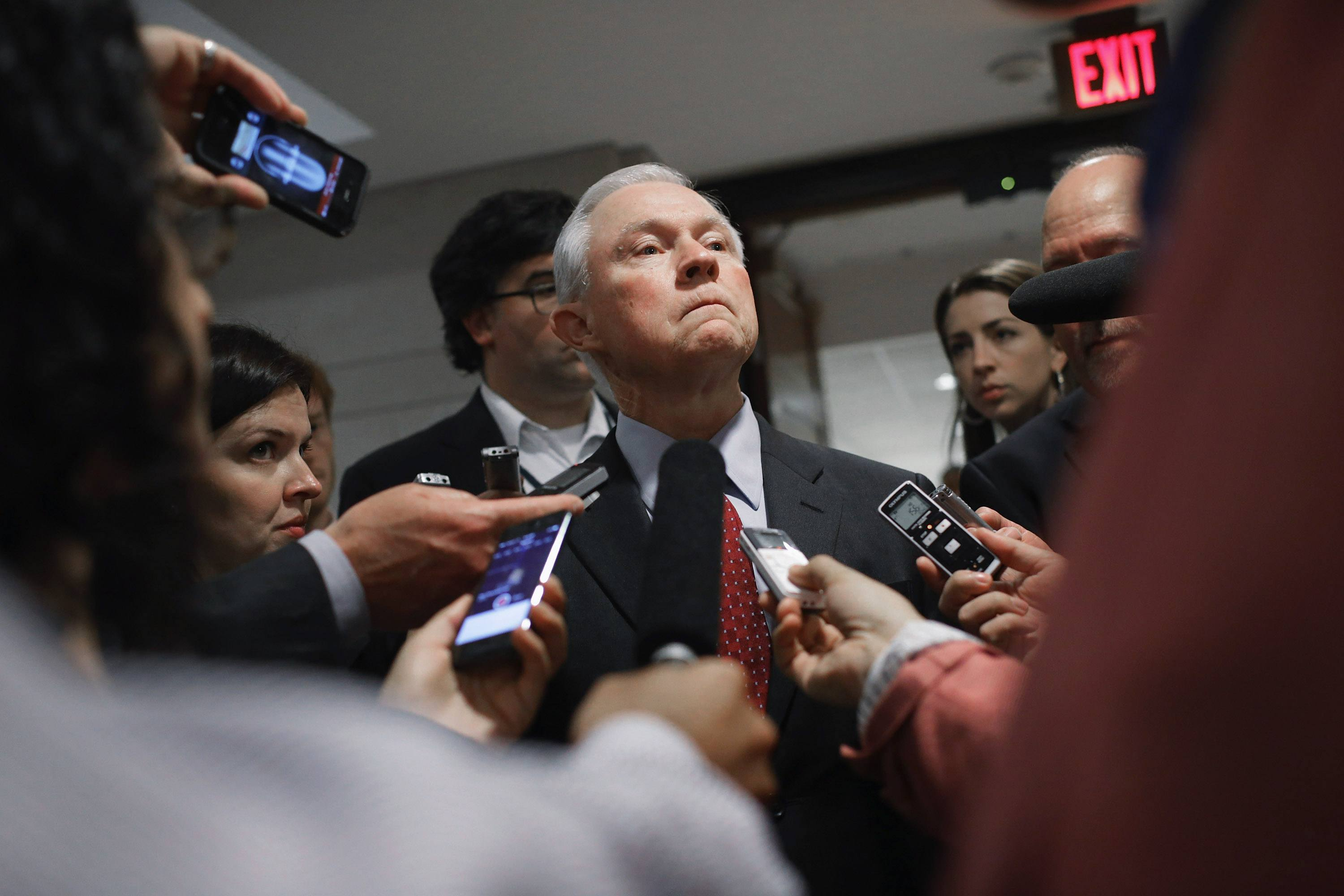 Attorney General Jeff Sessions talks with reporters