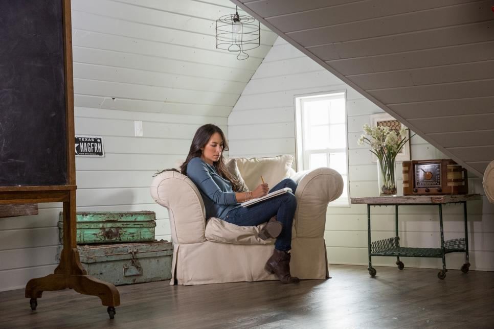 Joanna Gaines, co-host of HGTV's Fixer Upper, relaxes in a comfortable chair as she plans a renovation for a lucky family.