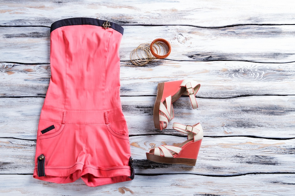 Salmon jumpsuit shorts with footwear. Girl's apparel on showcase. Brightness, style and quality.