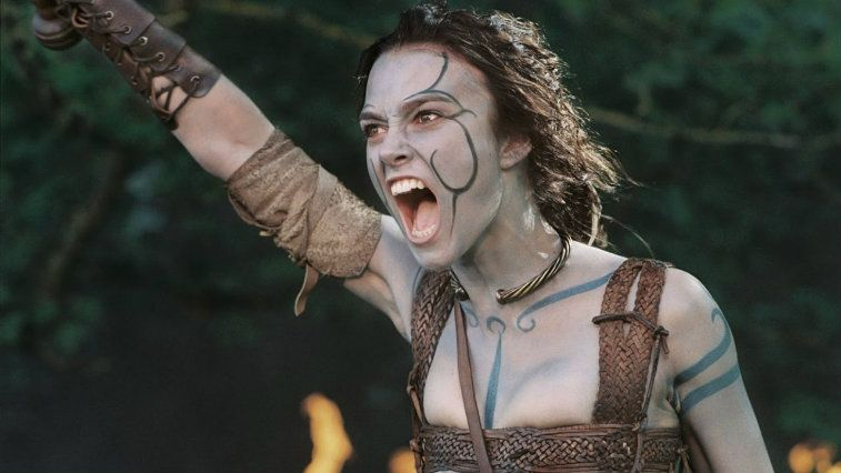 Keira Knightley covered in warpaint and delivering a battle cry in King Arthur