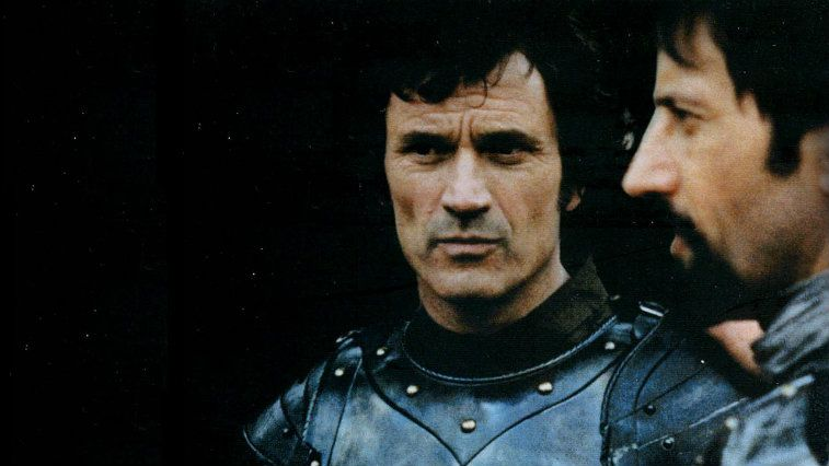 Luc Simon and Vladimir Antolek-Oresek in armor looking troubled in Lancelot of the Lake