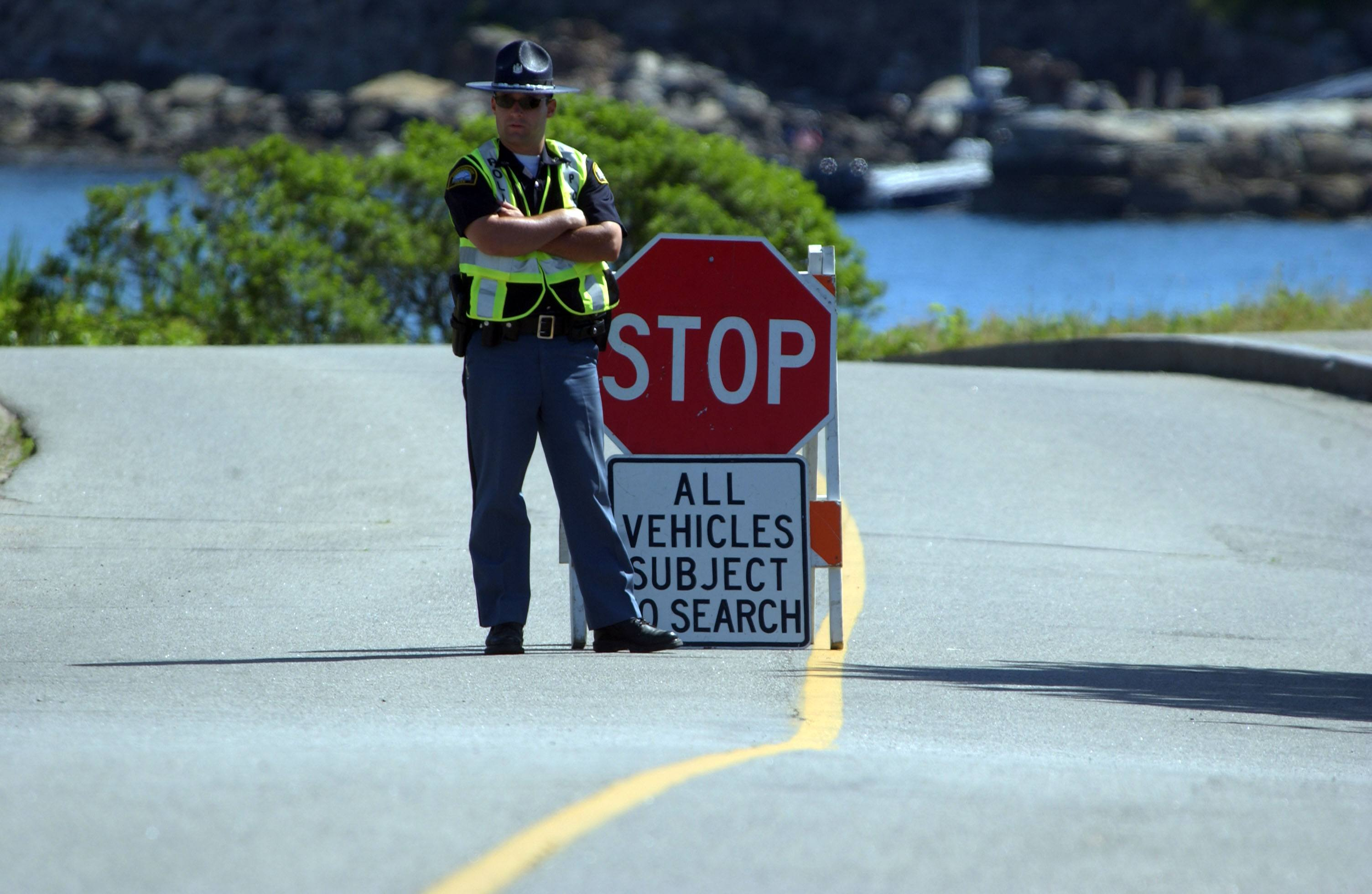 A state police officer mans a checkpoint