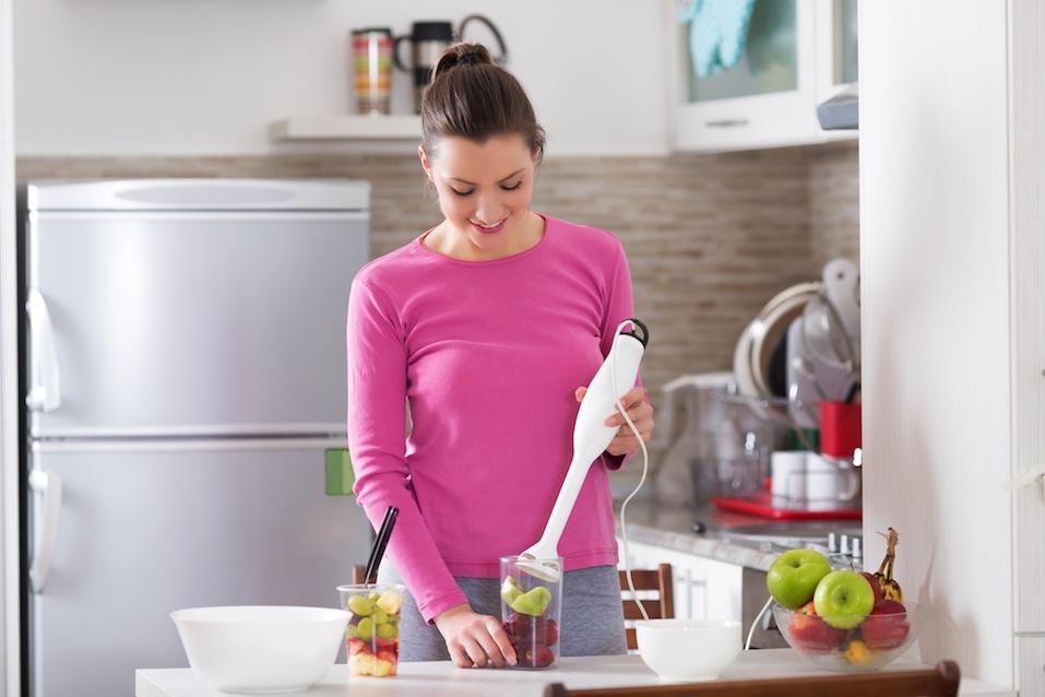 woman preparing a smoothie