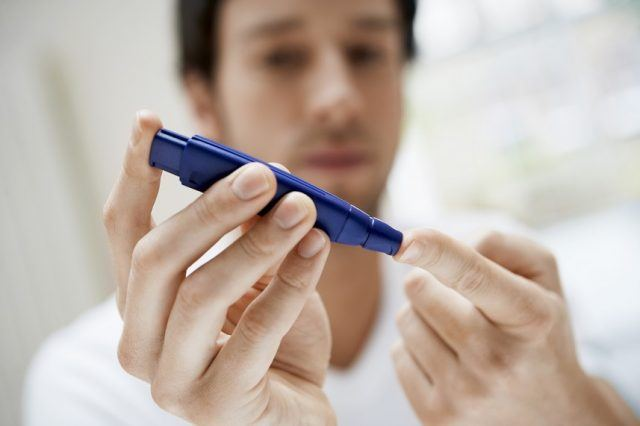 Man checking his insulin levels