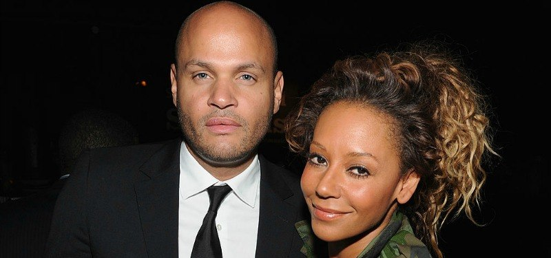 Stephen Belafonte looks seriously at the camera as Mel B smiles.