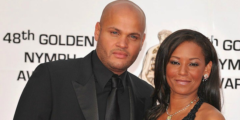Mel B and Stephen Belafonte pose together on the red carpet.