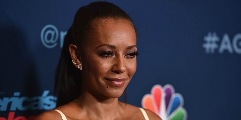 This is a close up of Mel B smiling and posing on the red carpet.