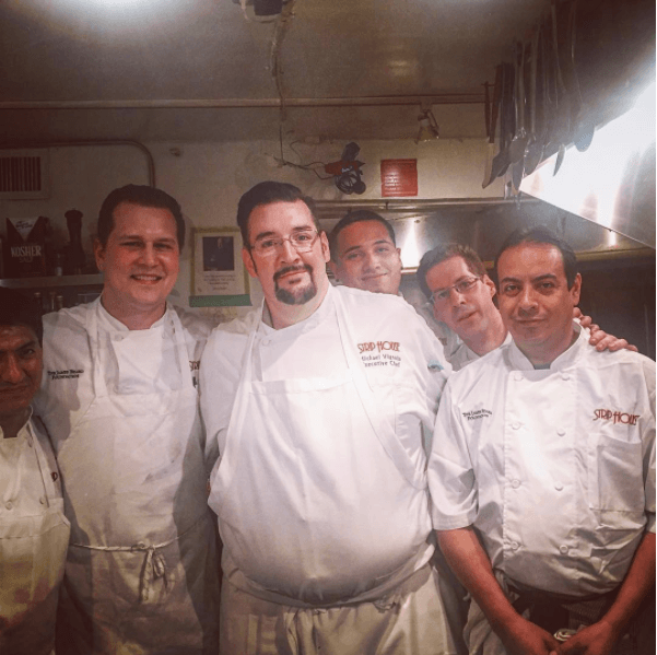 five chefs pose for a photo