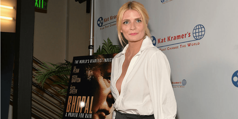 Mischa Barton stands next to a post of the movie, 'Bhopal' on the red carpet.