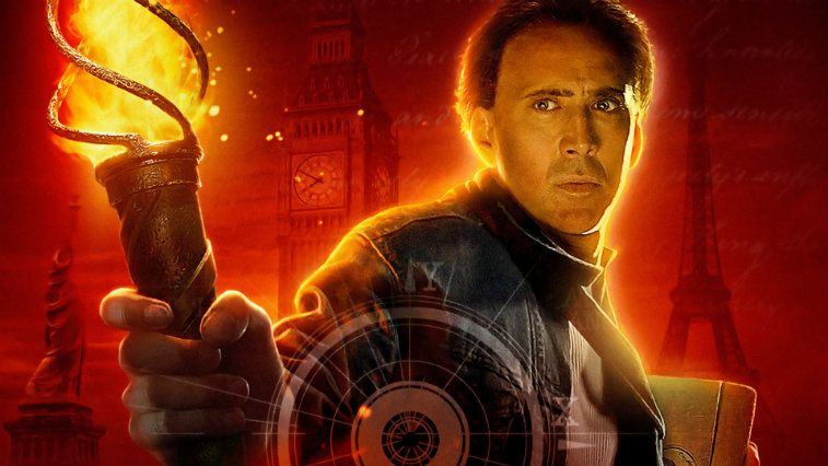 Nicolas Cage on the poster for National Treasure Book of Secrets holding a flame and looking serious