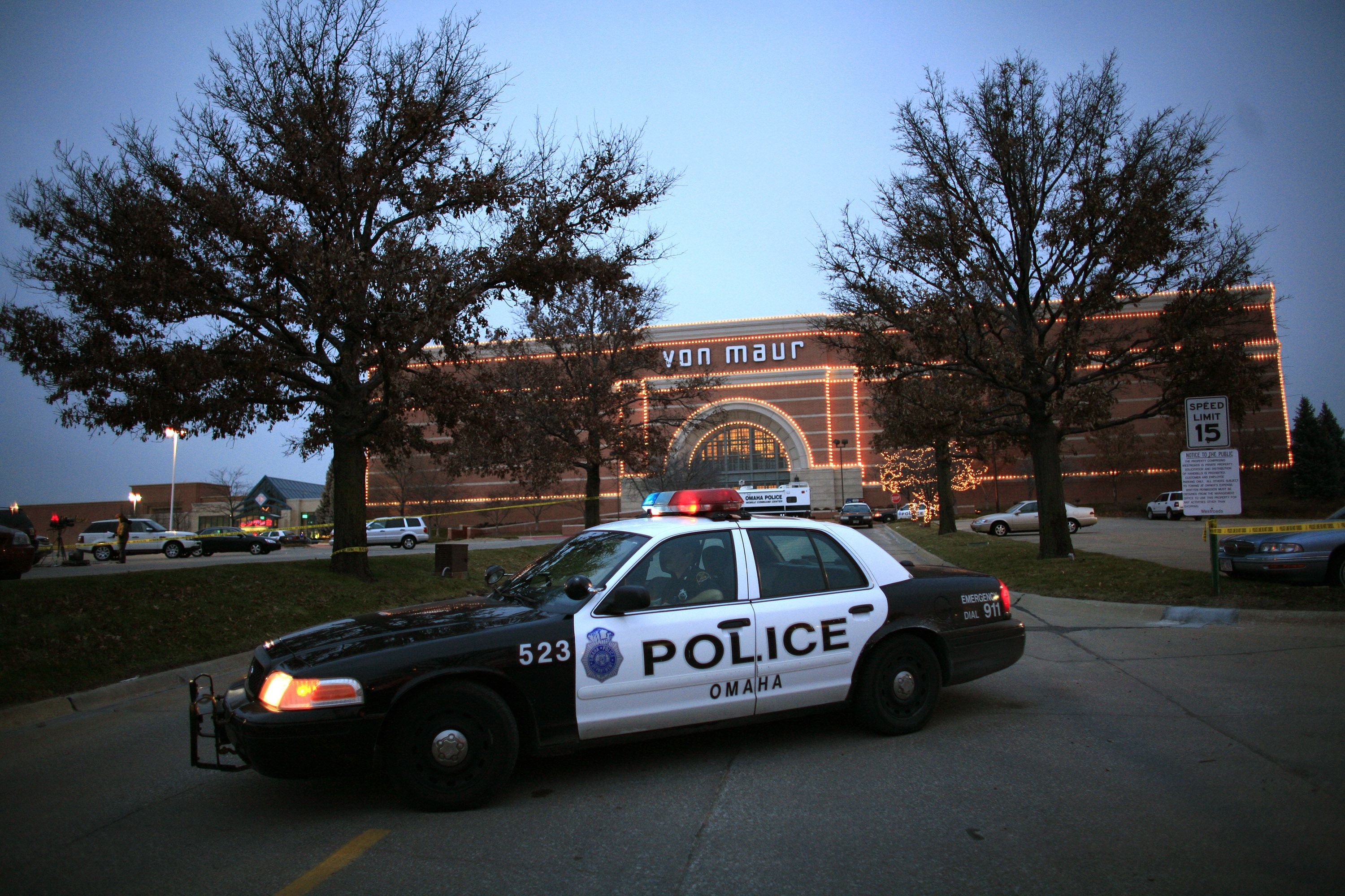 A police car sits in front of the Von Maur store at the Westroads Mall in Omaha, Nebraska
