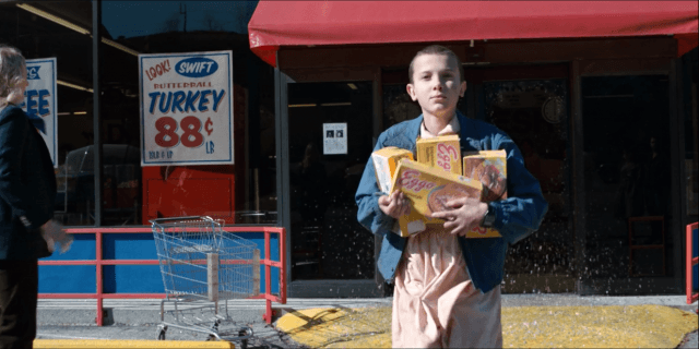 On 'Stranger Things,' Eleven (Millie Bobby Brown) steals waffles from the grocery store