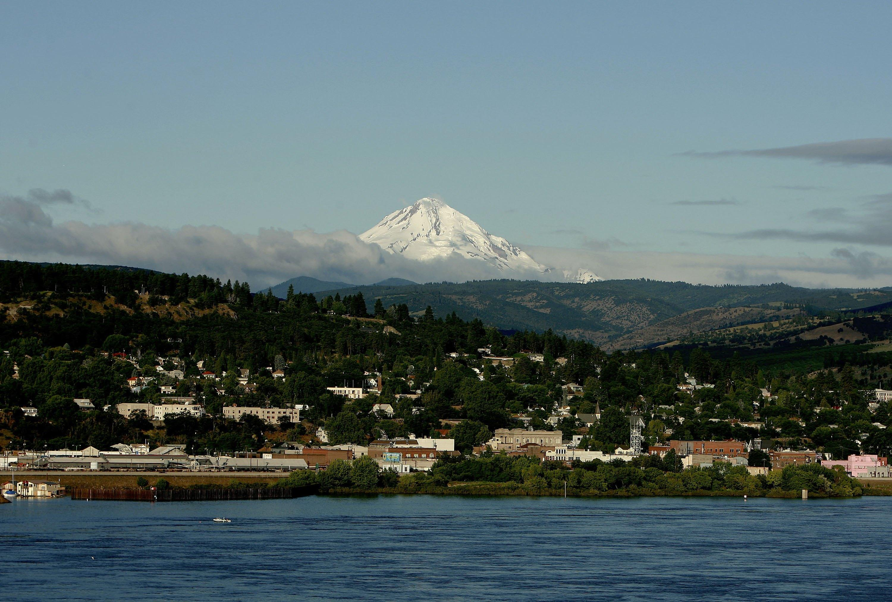 Mt. Hood rises in the background as the town of The Dalles is seen on the Columbia River