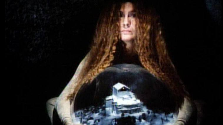 Amelie Syberberg holding a dome with a model city in Parsifal