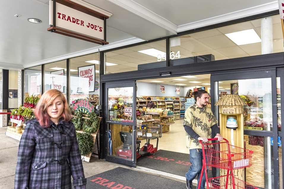 People walking at Trader Joes grocery store