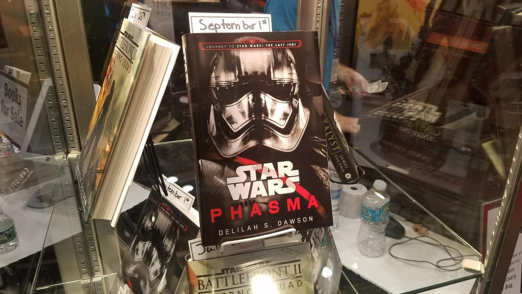 Captain Phasma's book in a glass case, with her chrome helmet pictured