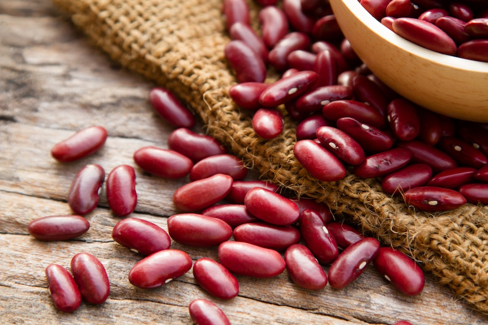 Dried red beans on wooden table