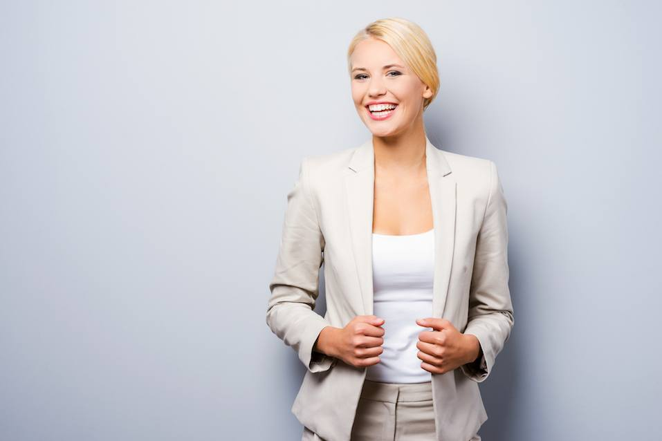 businesswoman holding hands on her jacket