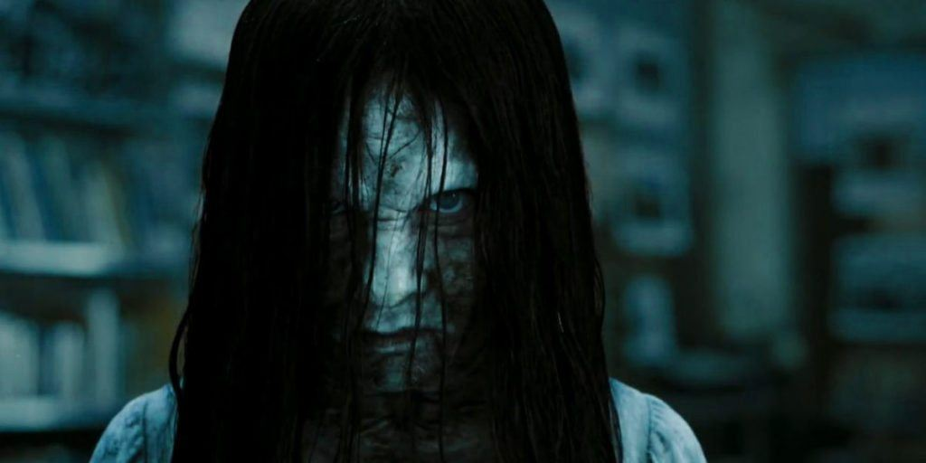 The ghost from Rings in close-up, staring straight into the camera