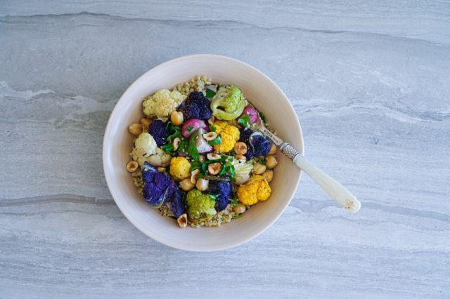 Roasted cauliflower and quinoa salad in a white bowl.