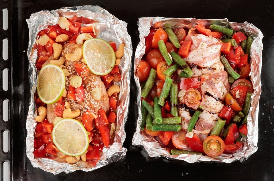Roasting pan with two uncooked dishes