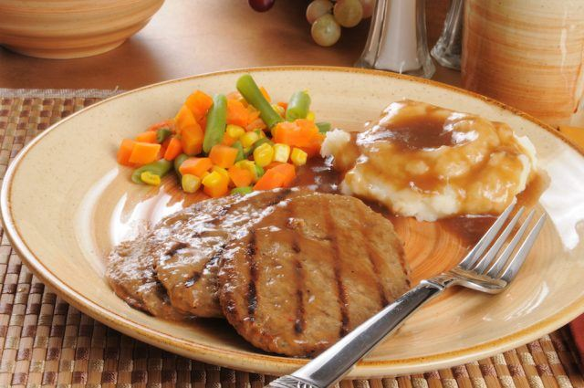 Salisbury steak dinner with mixed vegetables.