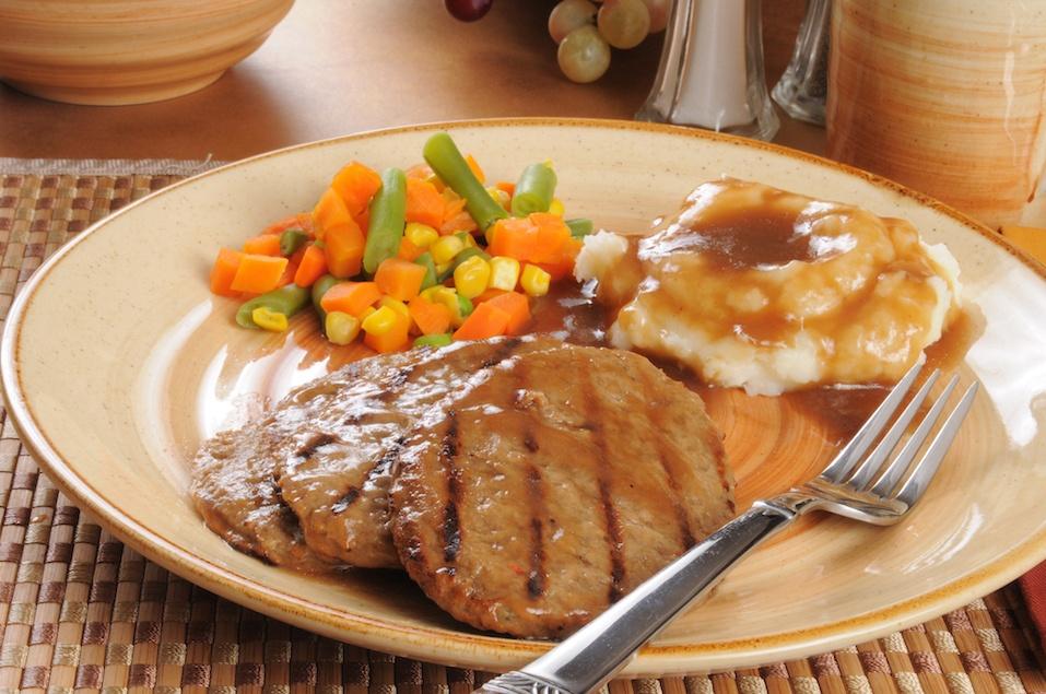 Salisbury steak dinner with mixed vegetables