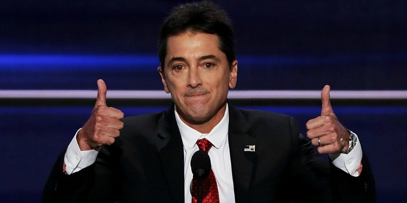 Scott Baio is on stage giving two thumbs up.