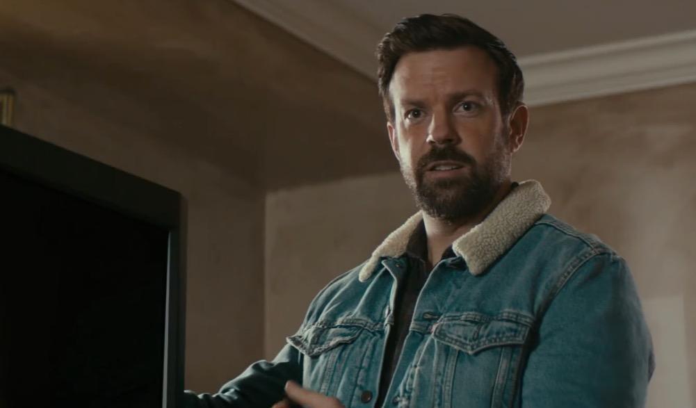 Jason Sudeikis in a jean jacket, looking straight ahead