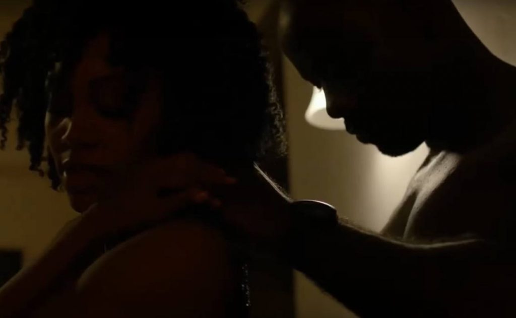 Misty Knight with her back to Luke Cage, up against a wall with their eyes closed