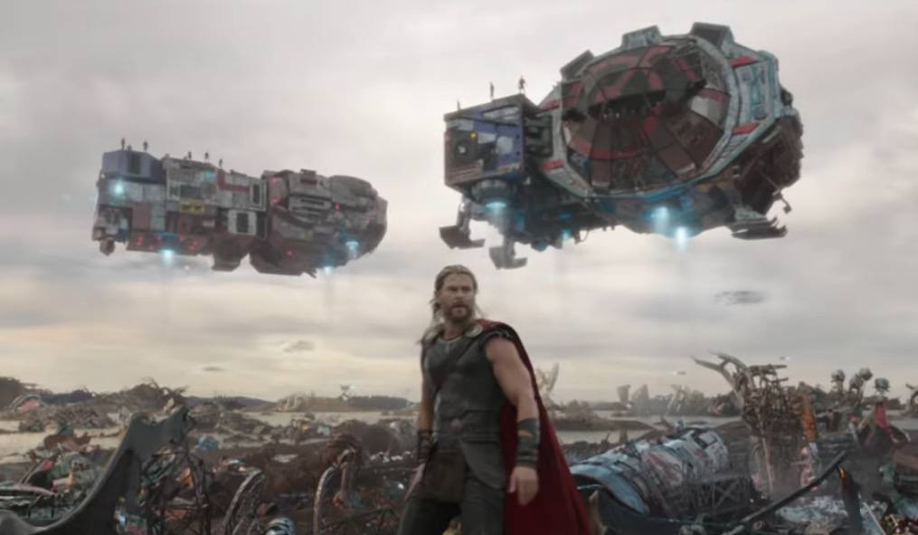 Thor in an alien junkyard, with various ships in the background