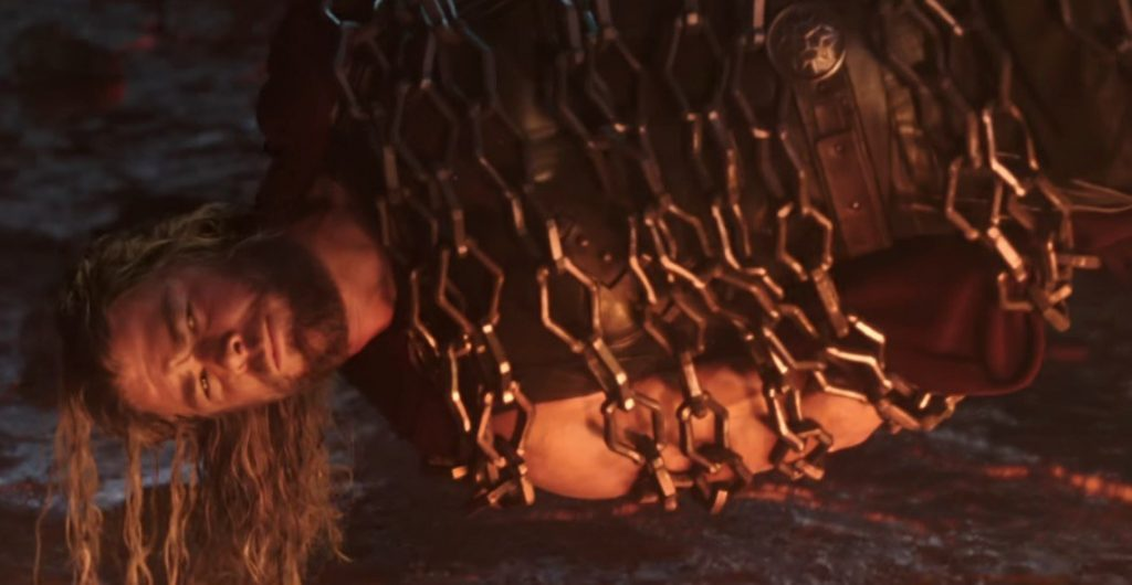 Thor parallel to the ground, wrapped in chains