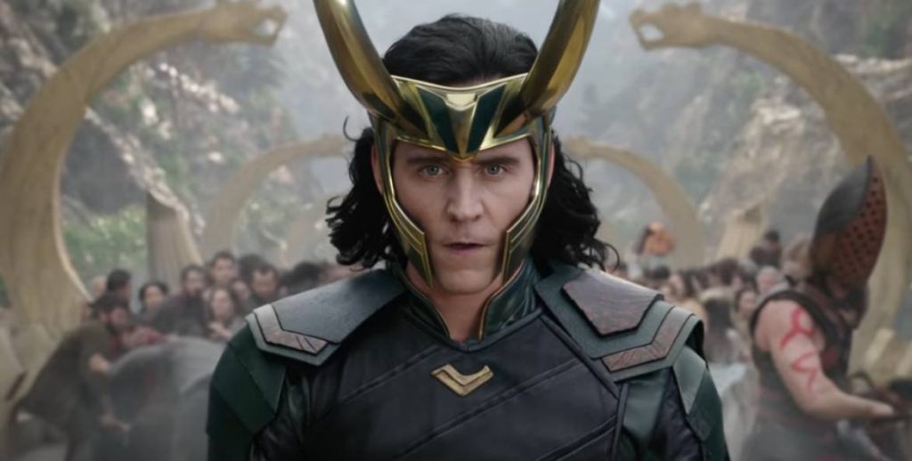 Loki with his horn helmet, looking directly at the camera