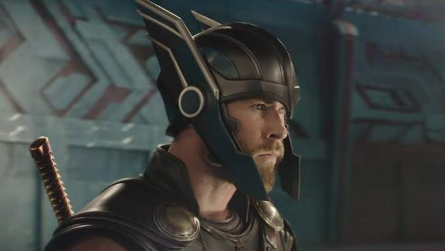 Thor looking to the right of the frame wearing his winged helmet.