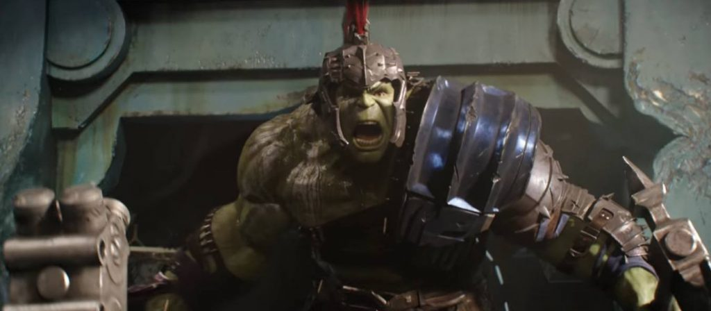 The Hulk holding weapons in either hand, yelling and wearing gladiator armor