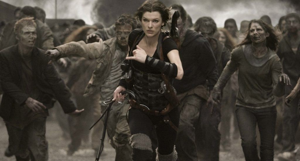 Milo Jovovich runs away from zombies, toward the camera