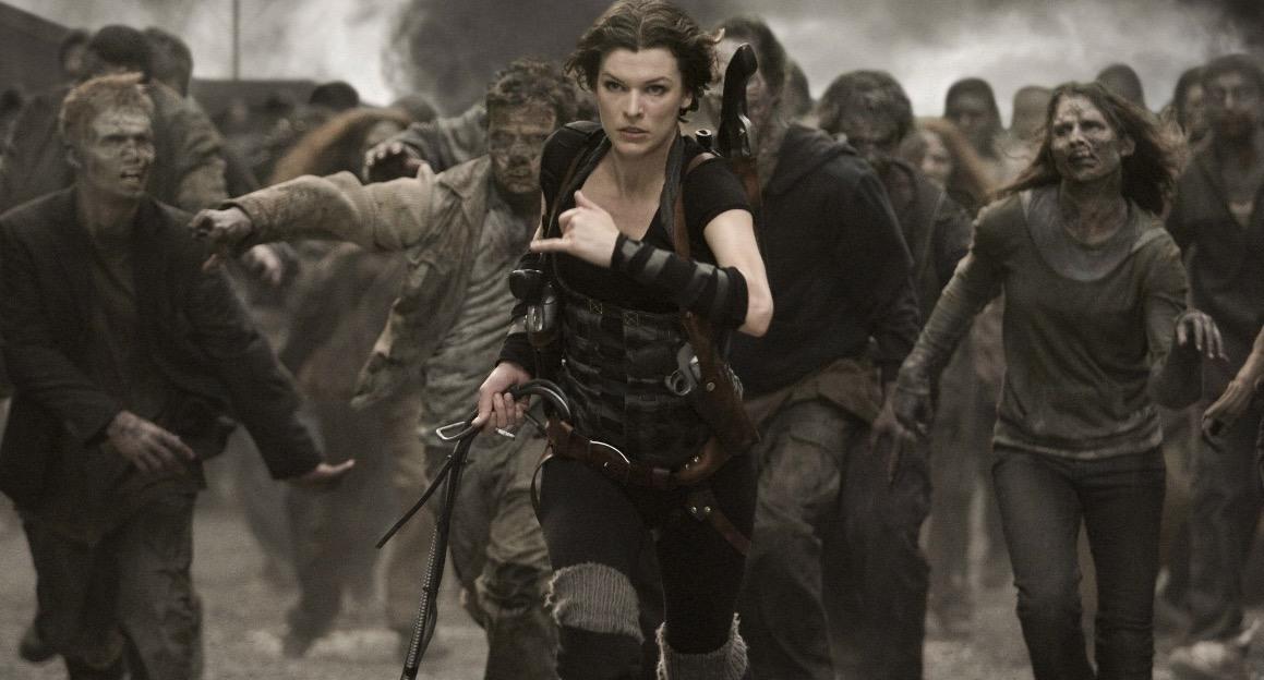 Milla Jovovich runs away from zombies, toward the camera