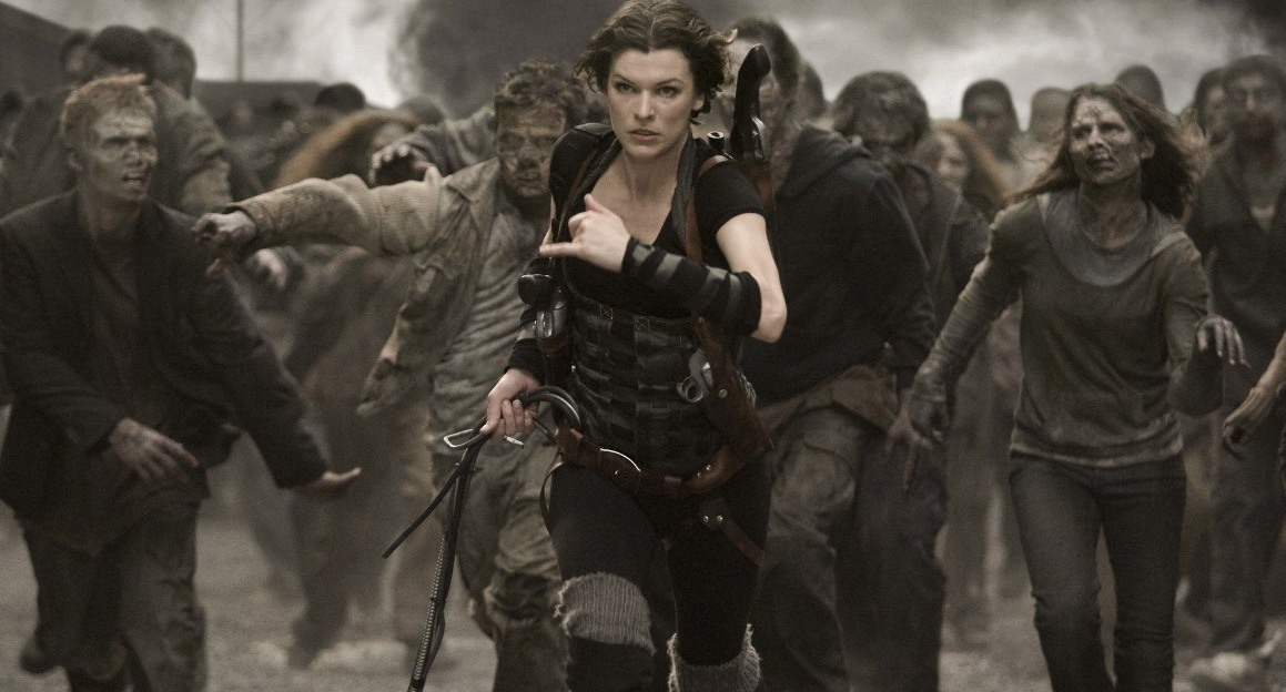 Milla Jovovich runs away from zombies, toward the camera